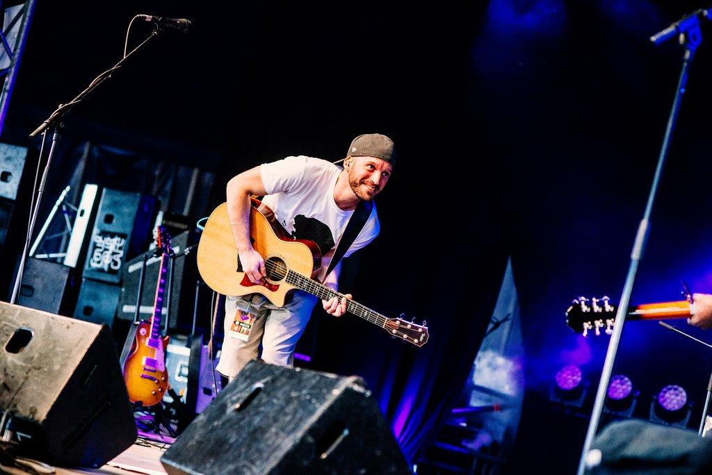 Féfé Live Concert Photo with Taylor Acoustic Guitar